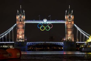 The Tower Bridge of London is lit up on August 1, 2012, on day 5 of the London 2012 Olympic Games as Great Britain won its first gold medal of the competition. AFP PHOTO / JOHANNES EISELE